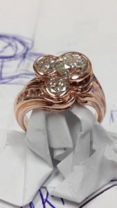 Custom Designed Rose Gold Three Stone Diamond Partial Bezel Set ring with Channel Set Diamonds